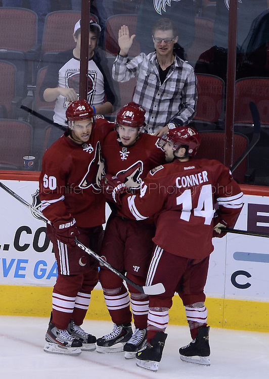 Apr. 6, 2013; Glendale, AZ, USA;  Phoenix Coyotes right wing Mikkel Boedker (89) celebrates with center Antoine Vermette (50) and forward Chris Conner (14) after scoring in the first period against the Colorado Avalanche at Jobing.com Arena. Mandatory Credit: Jennifer Stewart-USA TODAY Sports