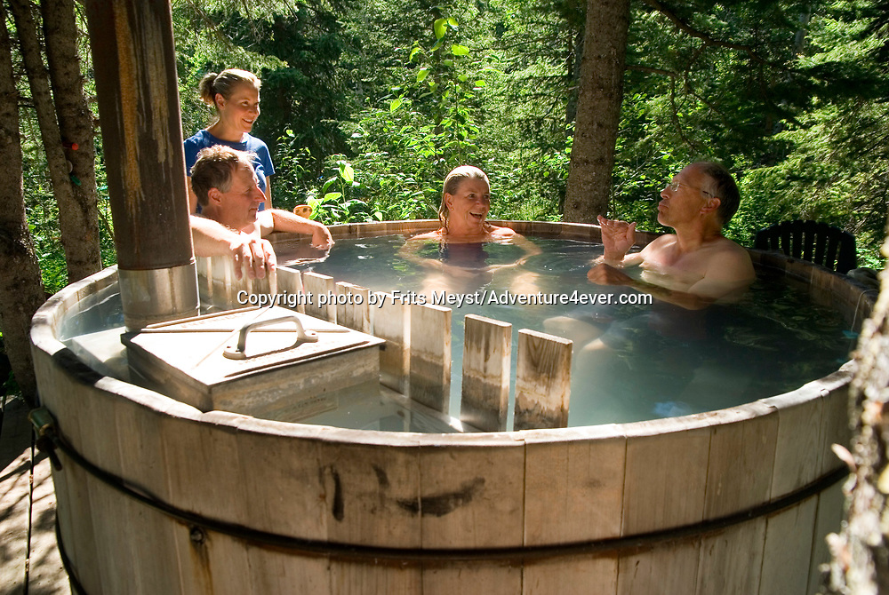 Mountain View, Alberta, Canada, July 2008. Relaxing in the wood burning hot tub in camp. Rancher Dan Nelson takes us on a horse back trail ride in the hills connecting the Albertan prairie with the mountains of Waterton National Park. Photo by Frits Meyst/Adventure4ever.com