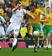 Norwich - Saturday March 27th, 2010:  Darel Russell of Norwich and Robert Snodgrass of Leeds in action during the Coca Cola League One match at Carrow Road, Norwich. (Pic by Paul Chesterton/Focus Images)