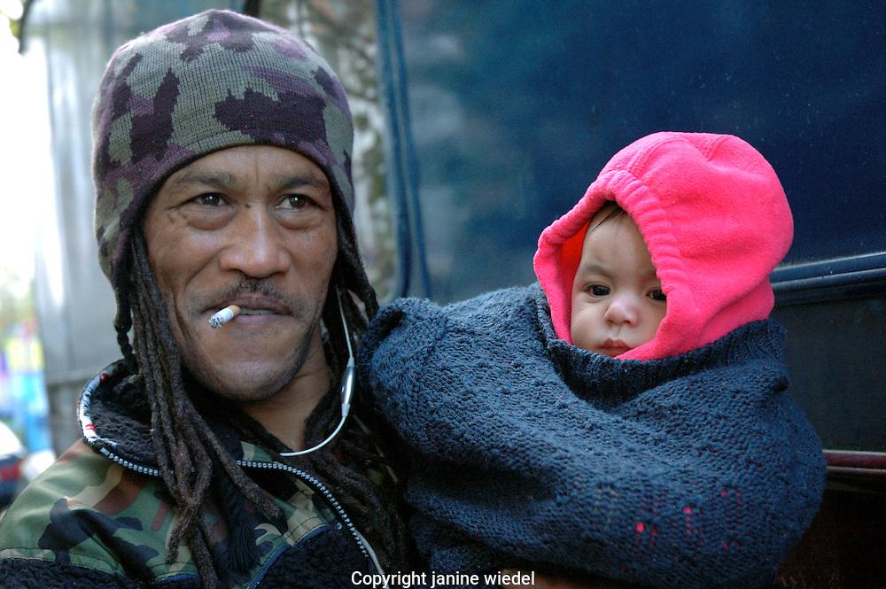 Rastafarian man with baby.
