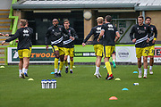 Cheltenham Town players warming up during the EFL Trophy match between Forest Green Rovers and Cheltenham Town at the New Lawn, Forest Green, United Kingdom on 4 September 2018.
