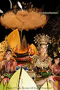 Traditionally costumed Thai women ride on a passing float during the annual Loi Krathong Festival parade in Chiang Mai, Thailand.