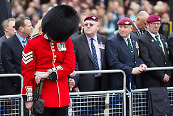 © Licensed to London News Pictures . 17/04/2013 . London , UK . A guardsman bows his head as the cortege passes at Ludgate Circus . The funeral of former British Conservative Prime Minister , Baroness Margaret Thatcher , today (Wednesday 17th April 2013) in Central London . Baroness Thatcher died from a stroke at the age of 87 . Photo credit : Joel Goodman/LNP
