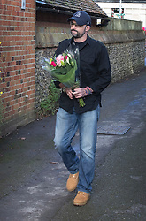 © Licensed to London News Pictures. 26/12/2016. Goring-, UK. Mark Elvidge 53, a fan of George Michael brings a floral tribute to house in Goring. Pop superstar George Michael died on Christmas day at his Oxfordshire home on the River Thames aged 53. Photo credit: Peter Macdiarmid/LNP