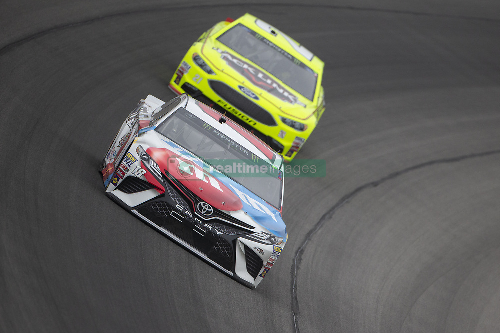 June 10, 2018 - Brooklyn, Michigan, United States of America - Kyle Busch (18) races off turn one during the FireKeepers Casino 400 at Michigan International Speedway in Brooklyn, Michigan. (Credit Image: © Stephen A. Arce/ASP via ZUMA Wire)