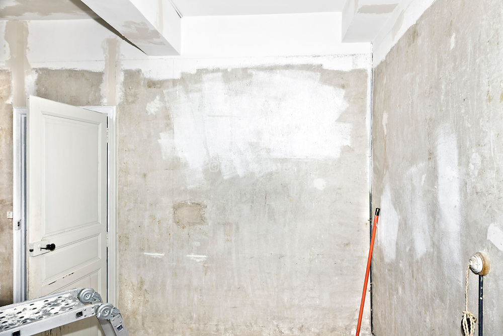 renovating and repairing old walls in a residential house