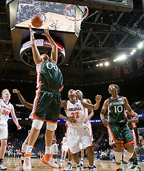 Miami Hurricanes center Amy Audibert (00) grabs a rebound against Virginia.  The University of Virginia Cavaliers defeated the Miami Hurricanes Women's Basketball Team 73-60 at the John Paul Jones Arena in Charlottesville, VA on February 4, 2007.