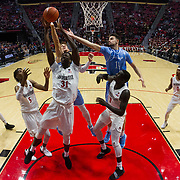 05 December 2018: San Diego State Aztecs forward Nathan Mensah (31) rebounds the ball in the first half with two Torero defenders on his back. The Aztecs lost to the Toreros 73-61 at Viejas Arena.