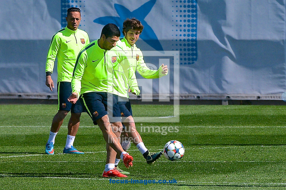 Lionel Messi of FC Barcelona (centre) pictured during training  at Ciutat Esportiva Joan Gamper, Sant Joan Desp&iacute; ahead of their UEFA Champions League last 16 second leg.<br /> Picture by Ian Wadkins/Focus Images Ltd +44 7877 568959<br /> 17/03/2015