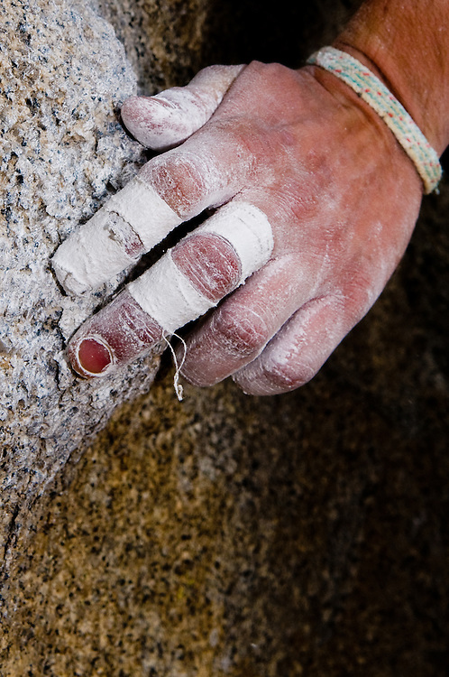 The hand of Spencer Church climbing 'King Tut' V3 on the 'Tut' boulder in the Buttermilks in Bishop, Calif., on Oct. 3, 2008. The Buttermilks are a popular climbing destination in the Eastern Sierra Nevada.