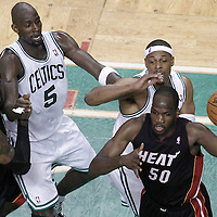 01 June 2012: Miami Heat center Joel Anthony (50) looks to pass past Boston Celtics small forward Paul Pierce (34) during the Boston Celtics 101-91 victory over the Miami Heat, in Game 3 of the Eastern Conference Finals playoff series, at the TD Banknorth Garden, Boston, Massachusetts, USA.