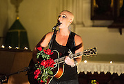 Signer Nell Bryden preforms at St Pancrus Church in London, September 14th , 2012 for the first time not wearing a wig..Last year during the recording of her album, Nell developed an stress-induced auto-immune disorder called Alopecia Totalis, which caused the rapid, complete and total loss of her hair. After keeping it quiet for over a year she decided to speak to the Mail On Sunday about her experience..Photos by Ki Price for The Times