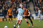 Huddersfield Town defender Tommy Smith (2)  during the Sky Bet Championship match between Huddersfield Town and Hull City at the John Smiths Stadium, Huddersfield, England on 9 April 2016. Photo by Simon Davies.