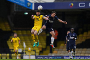 John Mousinho of Oxford United and Simon Cox of Southend United jump to head the ball during the EFL Sky Bet League 1 match between Southend United and Oxford United at Roots Hall, Southend, England on 6 October 2018.