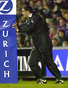 © Peter Spurrier/Intersport Images .Tel + 441494783165 email images@Intersport-images.com.27/12/2003 - Photo  Peter Spurrier.2003/04 Zurich Rugby Premiership Leicester v Leeds.Martin Johnson uses's the upright for his stretching before going on as a late second half sub.