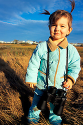 Biddeford, ME. A budding young naturalist explores a salt marsh near Biddeford Pool.  TPL project - Anuszewski property.