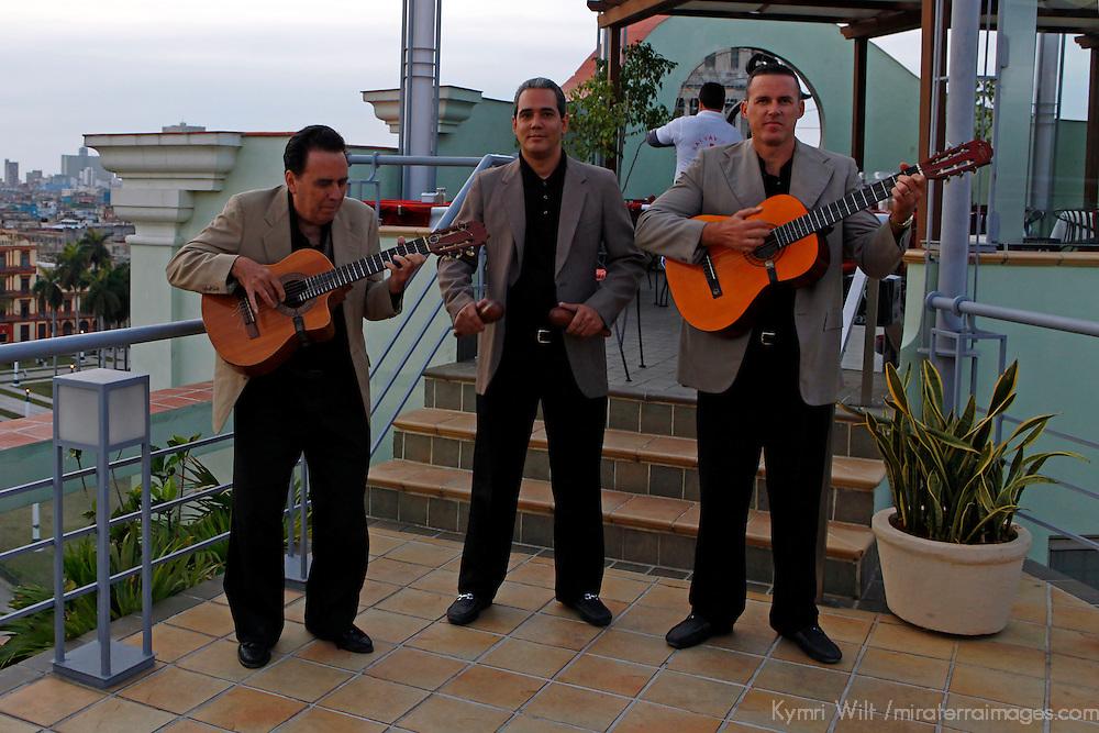 Central America, Cuba, Havana. Cuban musicians play on the rooftap of Hotel Saratoga in Havana.