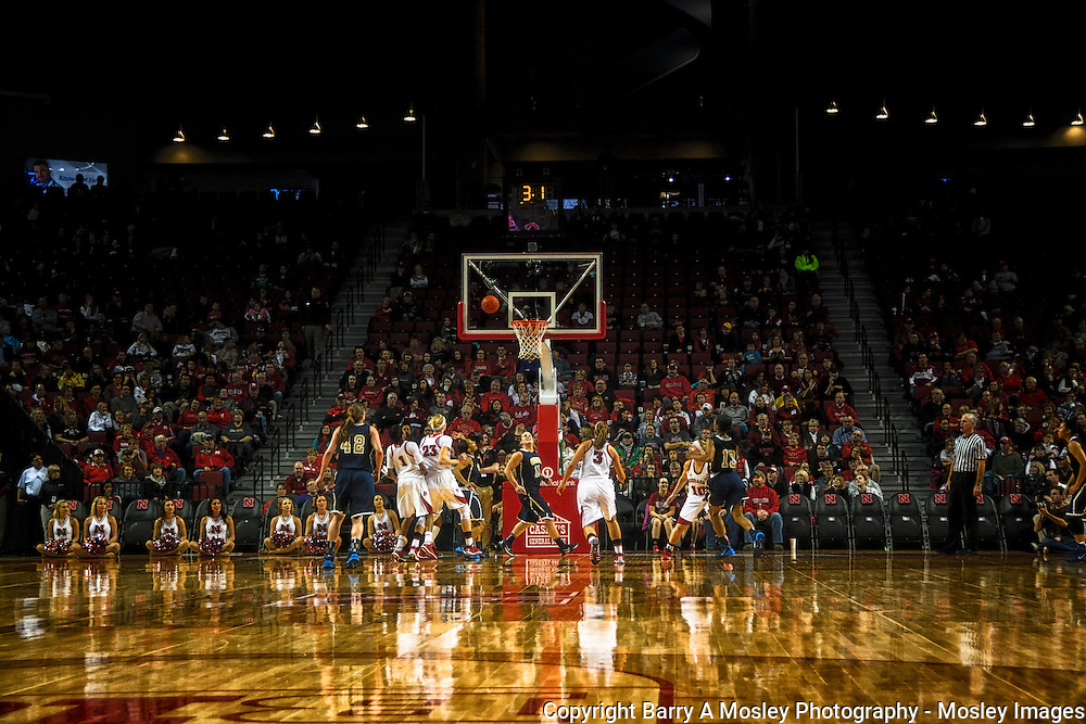 Wide view of collegiate women basketball players waiting for rebound. Image captured by Barry A Mosley Photography, Lincoln, Nebraska.