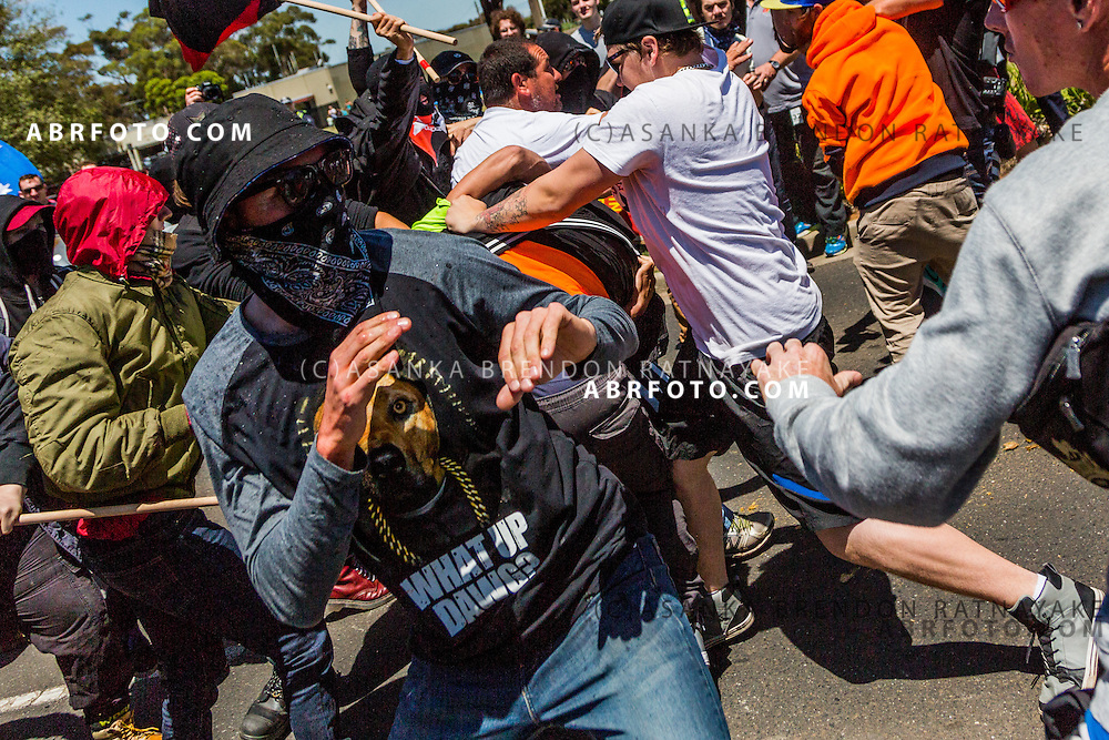 MELBOURNE, AUSTRALIA - NOVEMBER 22 : Anti-Fascist men wearing clash and fight with supporters of the Reclaim Australia group during a protest organised by the far right wing group Reclaim Australia. The Anti-Islamic group protested in the city of Melton on the outskirts of Melbourne voicing their opinions in relation to immigration and the building of Mosques and schools in the country. Melbourne, Australia November 22 2015.