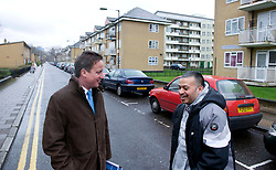 Leader of the Conservative Party David Cameron talks to a member of the public as he visits the Ocean Estate in Stepney, east London where he was shown around by 'London Citizens' Shahin Ahmed and Matthew Bolton(out of Shot) who are trying to improve the estate for local residents, Wednesday March 31, 2010. Photo By Andrew Parsons / i-Images.