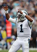 Carolina Panthers quarterback Cam Newton (1) points and celebrates after running for a third quarter gain of 9 yards during the 2015 NFL week 3 regular season football game against the New Orleans Saints on Sunday, Sept. 27, 2015 in Charlotte, N.C. The Panthers won the game 27-22. (©Paul Anthony Spinelli)