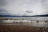 An sailboat sits anchored off the North Idaho College beach Wednesday as waves roll onto the shoreline. Avista has began its annual fall drawdown of Lake Coeur d'Alene in preparation for the winter season.