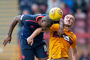 Uche Ikpeazu (#19) of Heart of Midlothian and Tom Aldred (#5) of Motherwell FC compete for a header during the Ladbrokes Scottish Premiership match between Motherwell and Heart of Midlothian at Fir Park, Motherwell, Scotland on 15 September 2018.