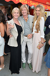Left to right, CHARLOTTE STOCKTING, NICKY CLARKE and KELLY SIMPKIN at a party to celebrate the 30th Anniversary of Chelsea Bun, Limerston Street, London SW10 on 2nd July 2014.