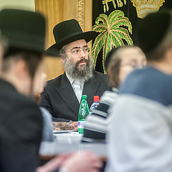 London, UK - 3 December 2014: a head teacher listen to Mr Stephen Williams MP, Parliamentary Under Secretary of State for Communities and Local Government, as he visits the Talmud-Torah Yetev-Lev orthodox Jewish school in Hackney, London