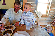 Ranch worker Andrew Anderson and his son Andy, eat grass-fed beef at the J Bar L Ranch dining hall on June 20, 2012 in the Centennial Valley, near Lakeview, Montana. The J Bar L, a member ranch of Yellowstone Grassfed Beef, works towards economic and ecological sustainability using holistic management techniques. The J Bar L is also a guest ranch, offering visitors a chance to herd cattle and learn about the holistic approach. <br />