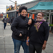 WASHINGTON, DC - NOV 16 :  Kimberly Gaines (Left) and Seshat Walker, community organizers who are profiling interesting people in their Deanwood neighborhood, stand outside the Riverside Center, November 16, 2013, in Deanwood, Washington, DC. Their project is called My Deanwood, and they photograph community members and write stories about them. (Photo by Evelyn Hockstein/For The Washington Post)