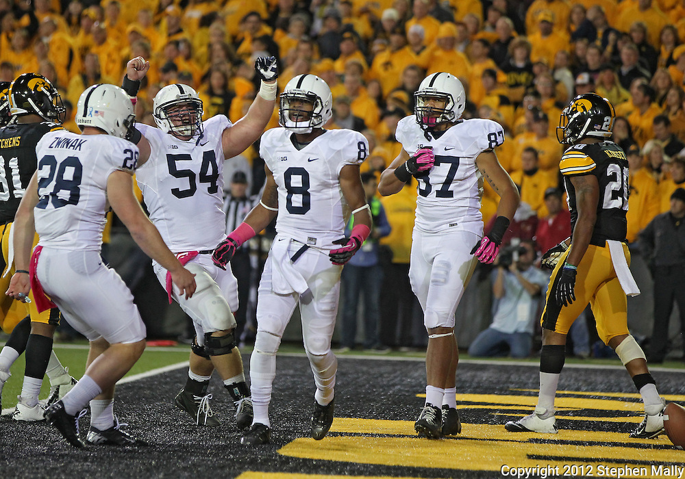 October 20 2012: Penn State Nittany Lions running back Zach Zwinak (28), center Matt Stankiewitch (54), wide receiver Allen Robinson (8), and tight end Kyle Carter (87) celebrate a touchdown during the first half of the NCAA football game between the Penn State Nittany Lions and the Iowa Hawkeyes at Kinnick Stadium in Iowa City, Iowa on Saturday October 20, 2012. Penn State defeated Iowa 38-14.