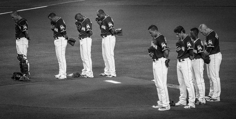 Marlins starting lineup stands in the pitching mound without scheduled starter Jose Fernandez who tragically passed away Sunday morning in a boating accident. <br />