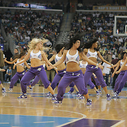 29 March 2009: New Orleans Hornets Honeybees dance team perform during a NBA game between Southwestern Conference rivals the New Orleans Hornets and the San Antonio Spurs at the New Orleans Arena in New Orleans, Louisiana.