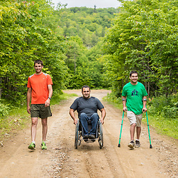 Three men explore the new Bethel Community Forest in Bethel, Maine.