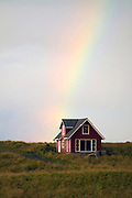 Old house with rainbow at Nyksund, Nordland, north-Norway.