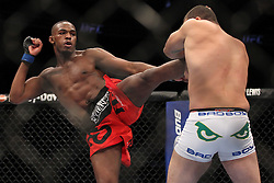 March 19, 2011; Newark, NJ, USA; UFC Light Heavyweight Champion Mauricio Rua (white trunks) and Jon Jones (red trunks) during their bout at UFC 128 at the Prudential Center.  Jones won the title via 3rd round KO.