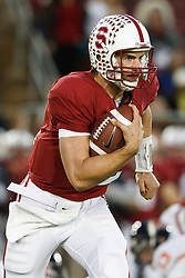 November 27, 2010; Stanford, CA, USA;  Stanford Cardinal quarterback Andrew Luck (12) rushes up field against the Oregon State Beavers during the first quarter at Stanford Stadium.  Stanford defeated Oregon State 38-0.