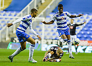 Aaron Tshibola with a foul on Johnny Russell during the Sky Bet Championship match between Reading and Derby County at the Madejski Stadium, Reading, England on 15 September 2015. Photo by Adam Rivers.