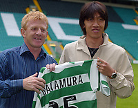 Shunsuke Nakamura parades at Celtic  park today with his new strip and number 25 after signing for Celtic with manager Gordon Strachan<br /> <br /> Pic ian Stewart, Friday 29th July 2005