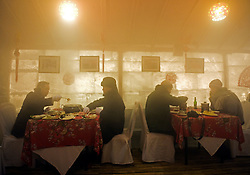 Diners eating dinner inside Ice Restaurant in a hotel in Harbin China during the Ice and Snow Festival in February 2009