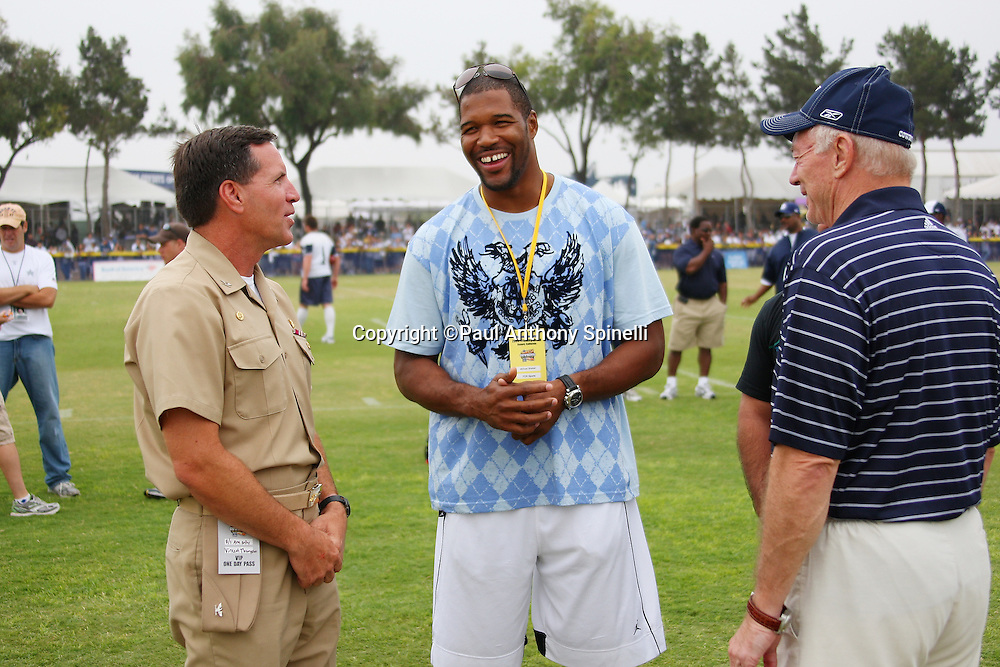 """OXNARD, CA - AUGUST 01:  Team Owner, President and General Manager Jerry Jones (right) of the Dallas Cowboys and Captain Brad """"Brick"""" Conners (left), the Commanding Officer of the Naval Base Ventura County, talk to former defensive end Michael Strahan of the New York Giants during the 2008 Dallas Cowboys Training Camp at River Ridge Field in Oxnard, California on August 1, 2008. ©Paul Anthony Spinelli *** Local Caption *** Jerry Jones;Brad Conners;Michael Strahan"""