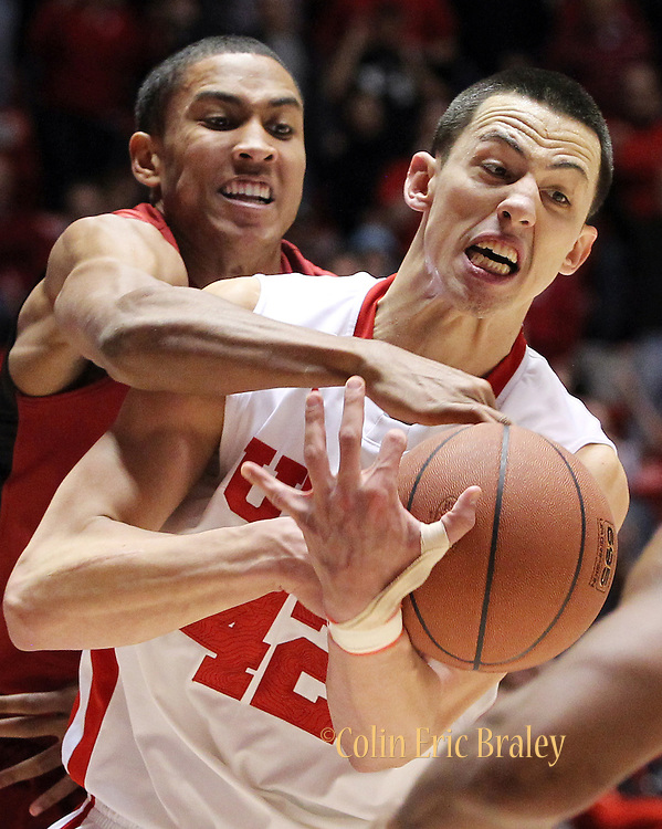 Utah center Jason Washburn, right, is fouled by Stanford center Josh Owens, left, during the second half of an NCAA college basketball game, Saturday, Feb. 25, 2012, in Salt Lake City. Utah defeated Stanford 58-57.(AP Photo/Colin E Braley).