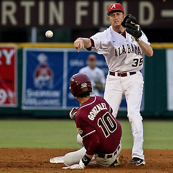 June 04, 2011; Tallahassee, FL, USA; Alabama Crimson Tide second baseman Josh Sanders (35) throws to complete a double play after forcing out Florida State Seminoles short stop Justin Gonzalex during the second inning of the Tallahassee regional of the 2011 NCAA baseball tournament at Dick Howser Stadium. Mandatory Credit: Derick E. Hingle