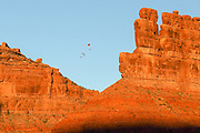 Visitors fly motorized parachutes in a scenic area outside of Monument Valley.