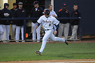 Ole Miss' Alex Yarbrough (2) scores on Ole Miss' Matt Snyder (33) double in the third inning vs. Jackson State at Oxford-University Stadium in Oxford, Miss. on Tuesday, March 15, 2011.