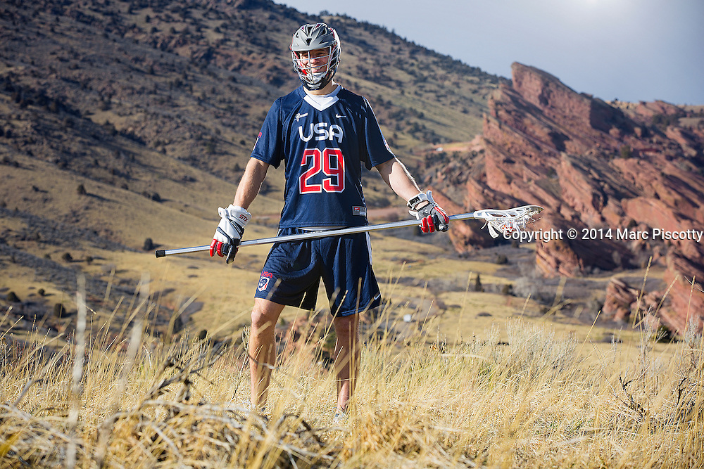 SHOT 2/22/14 3:55:34 PM - Denver Outlaws and Team USA defenseman Lee Zink poses for a portrait with Red Rocks and the foothills just outside of Denver, Co. in the background. Zink was named the 2012 Major League Lacrosse Defensive Player of the Year. When Zink grew up in Darien, Conn., and started his lacrosse career in sixth grade, he knew defense would be his calling card from the beginning. Zink will be playing in Denver this summer in the 2014 FIL World Lacrosse Championships.<br /> (Photo by Marc Piscotty / &copy; 2014)