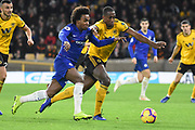 Wolverhampton Wanderers defender Willy Boly (15) battles with Chelsea Midfielder Willian during the Premier League match between Wolverhampton Wanderers and Chelsea at Molineux, Wolverhampton, England on 5 December 2018.