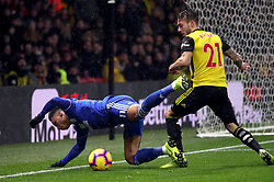 Cardiff City's Josh Murphy (left) and Watford's Kiko Femenia battle for the ball during the Premier League match at Vicarage Road, Watford.