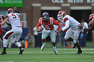 Mississippi quarterback Barry Brunetti (11) is tackled by Arkansas' JaMichael Wilson (6) at Vaught-Hemingway Stadium in Oxford, Miss. on Saturday, November 9, 2013. Mississippi won 34-24. (AP Photo/Oxford Eagle, Bruce Newman)